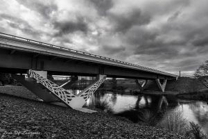 A bridge over the Waikato River adorned with Maori markings