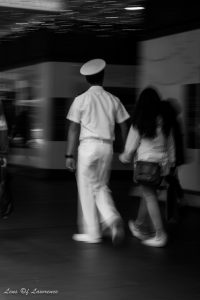 A candid shot of an off duty sailor and his girlfriend holding and hands and window shopping in Auckland New Zealand