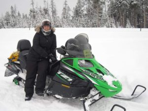 Cold Weather Photography Tips Tracey Lund with snow mobile
