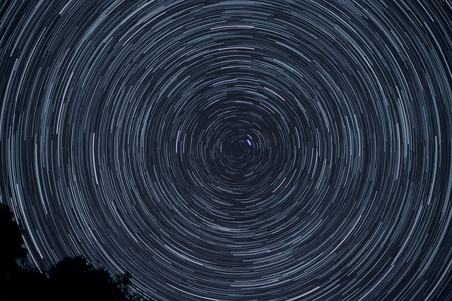 A photograph of star trails showing the circular movement of stars