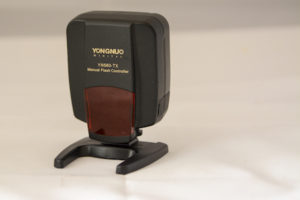 Front view of the compact Yongnuo 560-tx manual flash controller