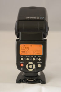 The rear view as seen by the photographer of the Yongnuo 560IV speed light showing the controls and settings panel
