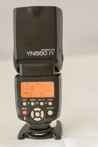 Yongnuo 560IV speed-light showing rear panel controls and flash pointing directly upwards