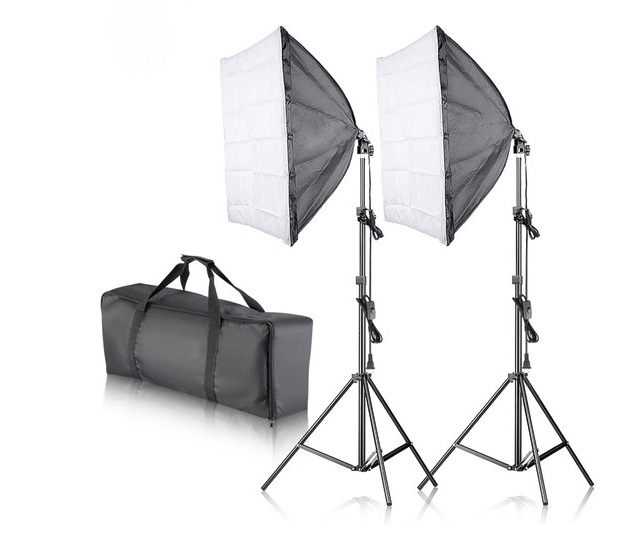 A Photography lighting kit for the studio or for out in the field showing two light stands and the carry bag
