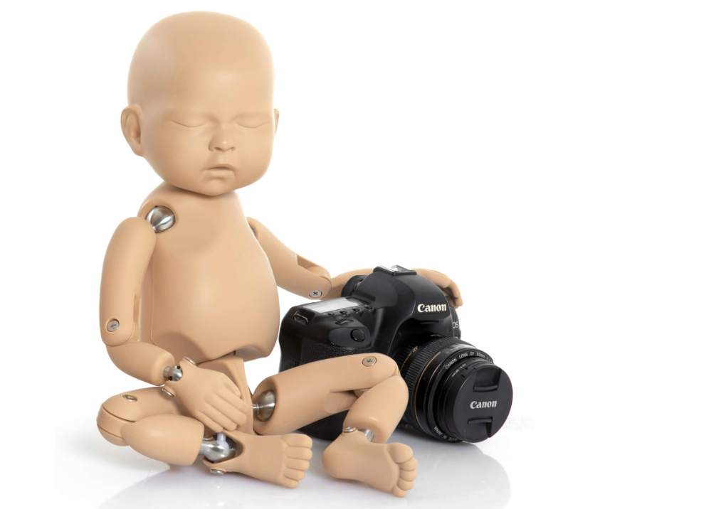 A photo of a StandInBaby with a camera