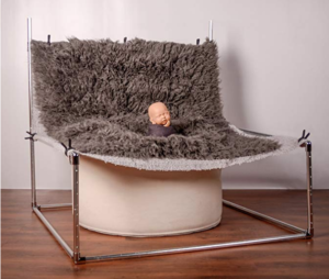 Image showing the set up of a newborn photo backdrop frame with blanket clamped to frame suspended over the beanbag