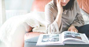 A woman looking at a Newborn photo album