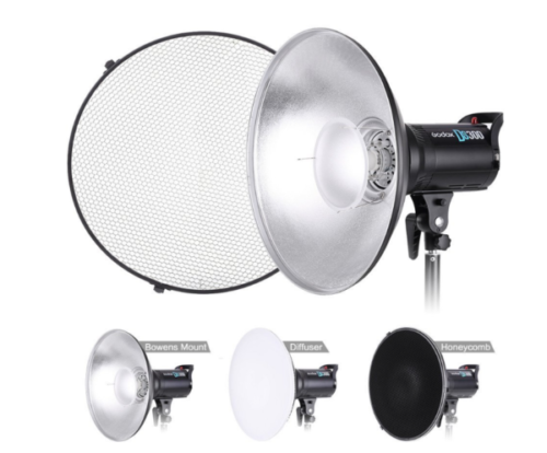 Image of an aluminium beauty dish mounted and showing the different diffuser attachments.